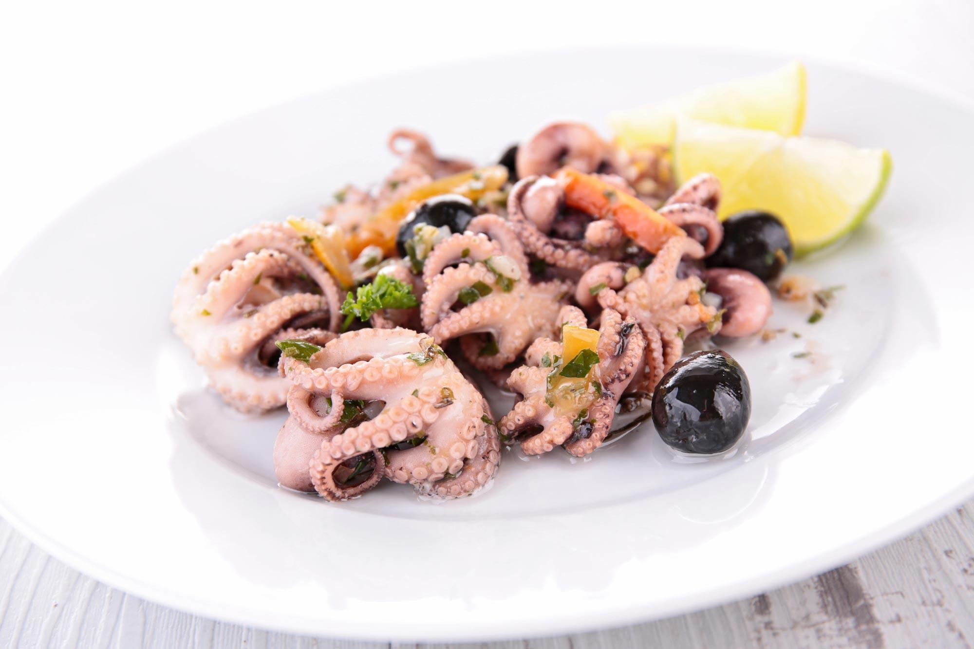 Blæksprutte i eddike og olie